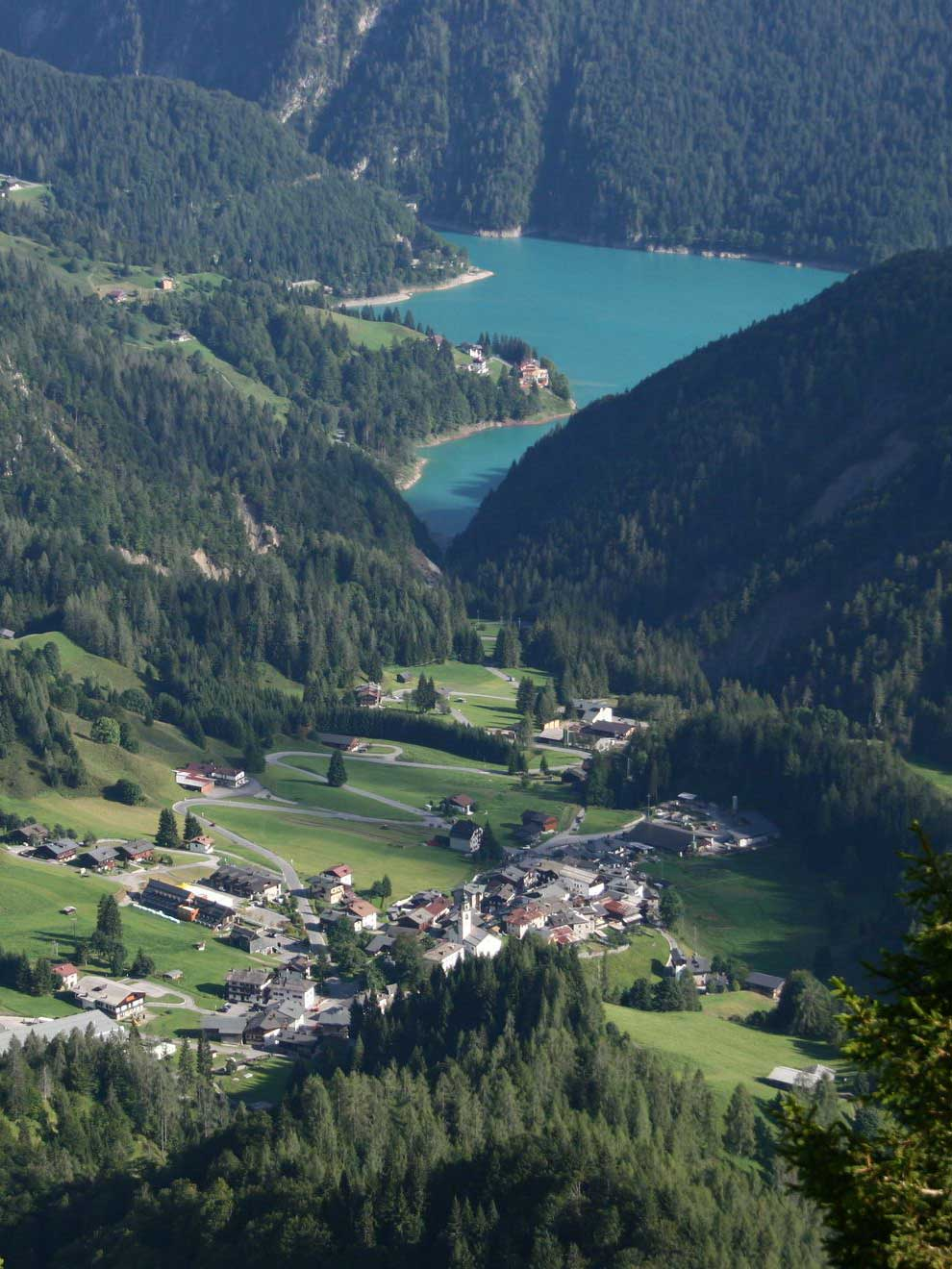 Sauris Lake: a green gem surrounded by a crown of mountains